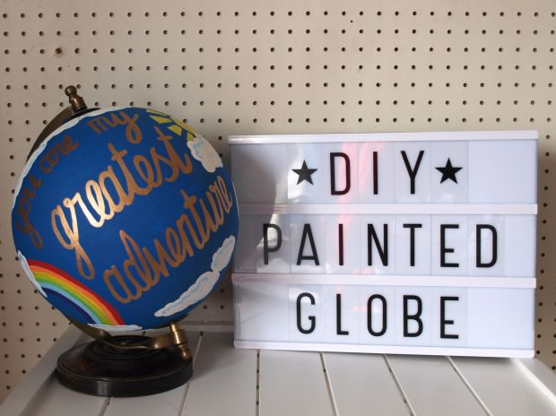 Painted globe sign